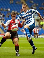 Photo: Ed Godden.<br />Reading v Feyenoord. Pre Season Friendly. 12/08/2006.<br />Tim Vincken (L) holds off Reading's Nicky Shorey.