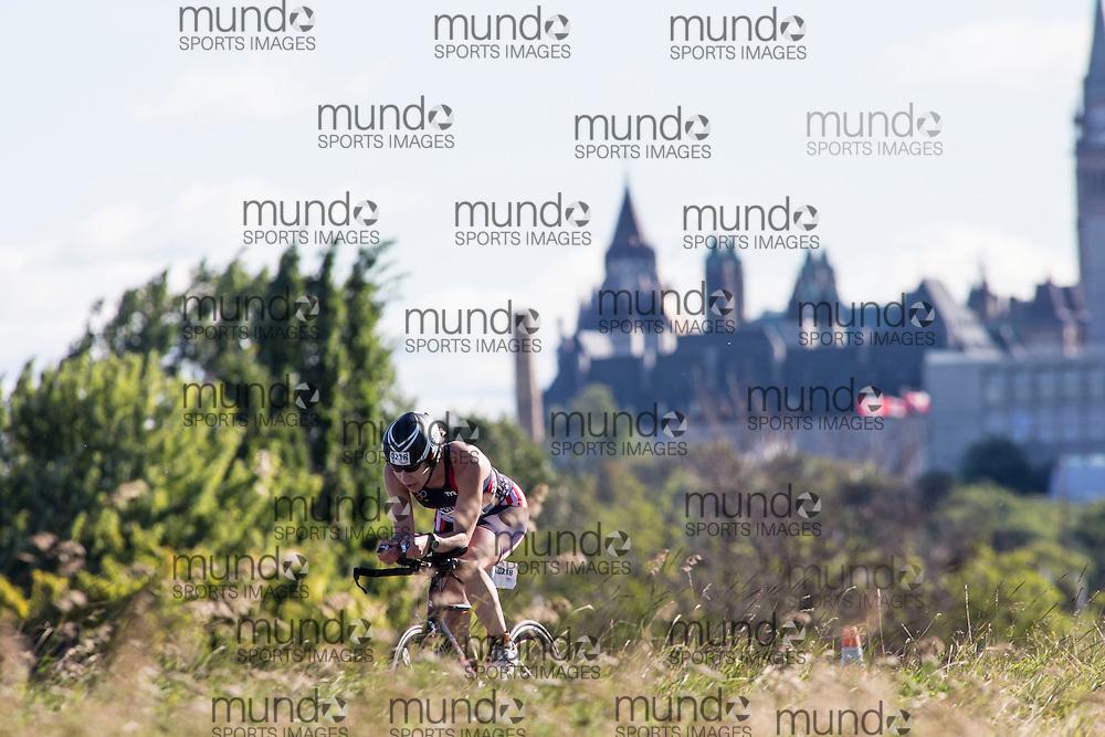 (Ottawa, Canada---10 August 2013)  Jennifer Scudiero (218)  of United States (USA) competing in the 30-34 Female AG International Triathlon Union 2013 World Duathlon Championships (10 km run- 40 km bike- 5km run).