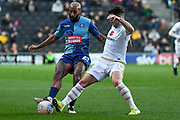 Milton Keynes Dons defender George Williams (2) battles for possession  with Wycombe Wanderers forward Josh Parker (27) during the EFL Sky Bet League 1 match between Milton Keynes Dons and Wycombe Wanderers at stadium:mk, Milton Keynes, England on 1 February 2020.