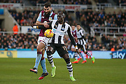Aston Villa midfielder Mile Jedinak (25) is held at b ay by Newcastle United midfielder Mohamed Diame (15)  during the EFL Sky Bet Championship match between Newcastle United and Aston Villa at St. James's Park, Newcastle, England on 20 February 2017. Photo by Simon Davies.