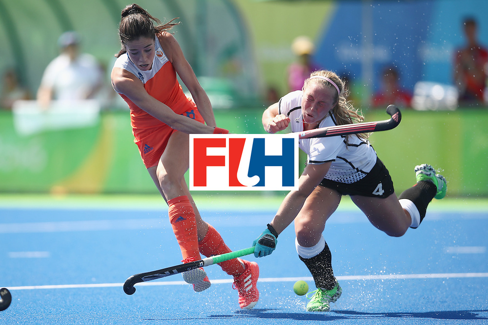 RIO DE JANEIRO, BRAZIL - AUGUST 17:  Naomi van As of the Netherlands shoots at goal under pressure from Nike Lorenz of Germany who was hit on the head with her stick during the womens semifinal match between the Netherlands and Germany on Day 12 of the Rio 2016 Olympic Games at the Olympic Hockey Centre on August 17, 2016 in Rio de Janeiro, Brazil.  (Photo by Mark Kolbe/Getty Images)