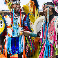Native American males chatting at ceremonial Pow Wow at Browning , Montana
