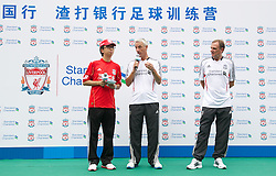 GUANGZHOU, CHINA - Wednesday, July 13, 2011: Liverpool's ambassadors Ian Rush and Phil Thompson during a coaching clinic for local youngsters at the Guangzhou Sports University during day three of the club's Asia Tour. (Photo by David Rawcliffe/Propaganda)