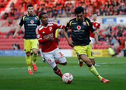 Nathan Byrne of Swindon Town is challenged by Malvind Benning of Walsall - Photo mandatory by-line: Rogan Thomson/JMP - 07966 386802 - 21/04/2015 - SPORT - FOOTBALL - Swindon, England - The County Ground - Swindon Town v Walsall - Sky Bet League 1.