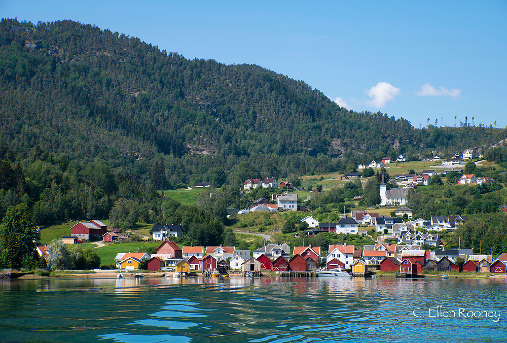 The view from a ferry of colourful timber buildings on the waterfront in Solvorn on Lustra Fjord, Vestlandet,  Norway, Scandanavia, Europe