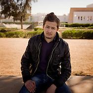 TUNISIA, SIDI BOUZID :Sam Judge, a young resident of Sidi Bouzid, poses for a portrait. Copyright Christian Minelli.