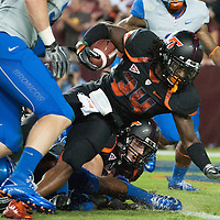 Virginia Tech Quarterback Tyrod Taylor (#5) drops back to pass in 1st quarter action as he is rushed by Boise State's' DT Fred Lee (#99). Virginia Tech defeated Boise State 21-14 in the game at FedEx Field in Landover, MD.