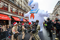 © Licensed to London News Pictures. 20/11/2016. London, UK. A giant Marshmallow Man and performers dressed as Ghostbusters with over 400 other cast members of Hamley's Toy Parade march along Regent Street in London in a colourful extravaganza, with marching bands, dancers and toy vehicles. Photo credit: Tolga Akmen/LNP