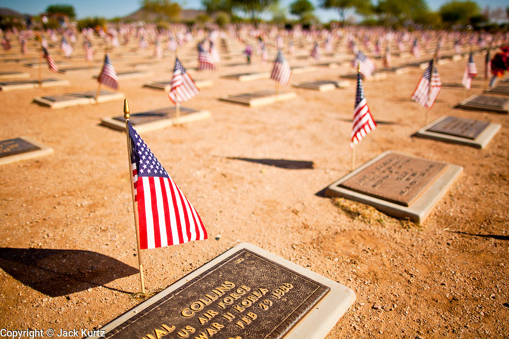 30 MAY 2011 - PHOENIX, AZ:  American flags on veterans' grave sites during Memorial Day services in the National Memorial Cemetery in Phoenix, AZ, Monday. Memorial Day was celebrated with services across the United States Monday.    Photo by Jack Kurtz