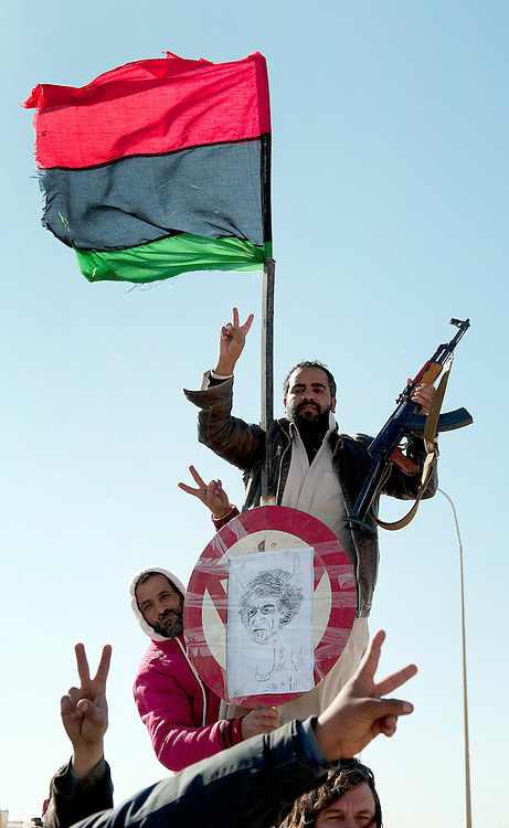 Memebers of the opposition pose in front of the pre 1969 Libyan Flag at the border with Egypt.