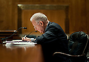 "Former Rep. LEE HAMILTON (D-IN), former vice chairman of the National Commission on Terrorist Attacks Upon the United States, prepares before testifing before the Senate Homeland Security and Governmental Affairs Committee on the ""9/11 Commission Report 10 Years Later."""