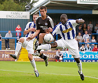 Photo. Daniel Hambury.<br /> Colchester United v Chelsea XI. Pre Season Friendly.<br /> 30/07/2005.                              <br /> Chelsea's Fiulipe Morais gets in between Colchester's George Elkobi and Jamie Tandy (r/h/s).