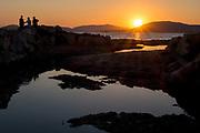 Three men at the sunset, Alghero July 12, 2017