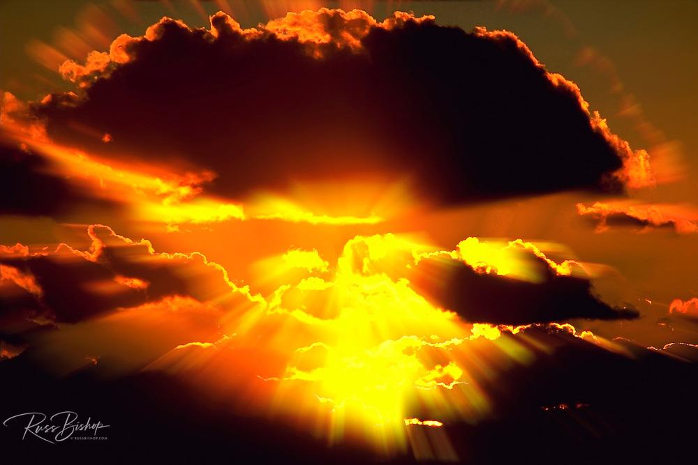 Golden rays through clouds at sunset, Ventura, California USA