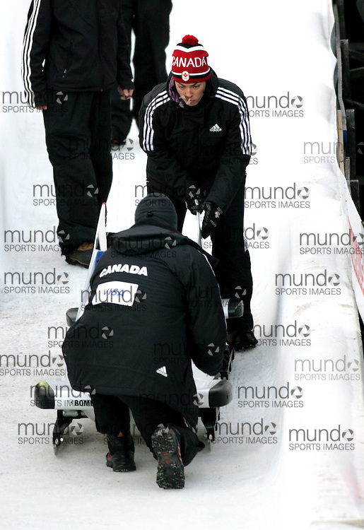 (November 21, 2009) Veronique of the Canadian Team prepares to hoist a sled off the track after a run at the Federation Internationale de Bobsleigh et de Togogganing (FIBT) two-man men's bobsled World Cup race at the Olympic Sports Complex in Lake Placid, New York.
