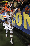 ATLANTA - DECEMBER 04:  Quarterback Cam Newton #2 of the Auburn Tigers celebrates with the crowd after the 2010 SEC Championship against the South Carolina Gamecocks at Georgia Dome on December 4, 2010 in Atlanta, Georgia.  The Tigers beat the Gamecocks 56-17.  (Photo by Mike Zarrilli/Getty Images)