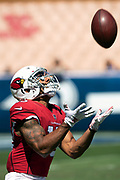 Arizona Cardinals rookie wide receiver Christian Kirk (13) looks up for the ball as he catches a punt while warming up before the 2018 NFL regular season week 2 football game against the Los Angeles Rams on Sunday, Sept. 16, 2018 in Los Angeles. The Rams won the game in a 34-0 shutout. (©Paul Anthony Spinelli)