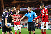 Charlton Athletic midfielder Darren Pratley (15) complains to the referee Stephen Martin during the EFL Sky Bet Championship match between Middlesbrough and Charlton Athletic at the Riverside Stadium, Middlesbrough, England on 7 December 2019.
