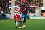 Doncaster Rovers Midfielder Matty Blair (17) Scunthorpe United defender Cameron Burgess (21) (right) battle for possession during the The FA Cup match between Doncaster Rovers and Scunthorpe United at the Keepmoat Stadium, Doncaster, England on 3 December 2017. Photo by Craig Zadoroznyj.