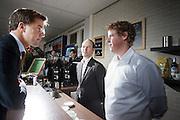 Mark Rutte praat met twee leerlingen van het ROC in Nieuwegein. Minister-president Mark Rutte bezoekt het ROC in Nieuwegein om het schooljaar van ROC Midden-Nederland af te trappen. Na een bezoek aan de horeca-afdeling bezoekt Rutte het Automotive College, een samenwerking van het ROC met brancheorganisatie Innovam.<br /> <br /> Mark Rutte talks to two students from the ROC in Nieuwegein. Prime Minister Mark Rutte visits to the ROC in Nieuwegein, to start the school season of the ROC Midden-Nederland. After a visit to the catering department Rutte visit the Automotive College, a collaboration of the ROC with Innovam.