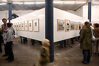 "30 SEP 2005, BERLIN/GERMANY:<br /> Besucher in der Ausstellung, Eroeffnung der Ausstellung ""Neueinstellung"" der Fotografenagentur Ostkreuz, Pfefferberg<br /> IMAGE: 20050930-01-044"