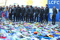 Leicester City players gather to look at the tributes at Leicester City Football Club. PRESS ASSOCIATION Photo. Picture date: Friday November 2, 2018. Leicester Chairman, Vichai Srivaddhanaprabha, was among those to have tragically lost their lives on Saturday evening when a helicopter carrying him and four other people crashed outside King Power Stadium. See PA story SOCCER Leicester. Photo credit should read: Nigel French/PA Wire