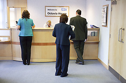 Group waiting in the reception area of NHS Octavia House,