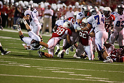 20 September 2008: Tony Trujillo gets a hand on Chevron Walker as Mike Piton is clothes lined by Mike Scheibel and Eric Rettke to keep him out of the play during Illinois State Redbirds home opener lose to the #20 ranked Eastern Illinois Panthers at Hancock Stadium on the campus of Illinois State University in Normal Illinois. Final score was 25-21.