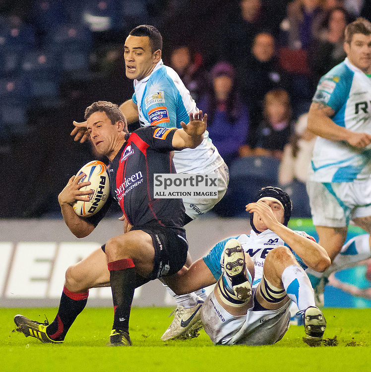 Chris Leck is dragged to the floor by Ian Gough, Edinburgh Rugby v Ospreys, RaboDirect Pro12 League