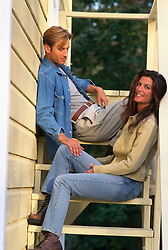 Couple at a house sitting on steps