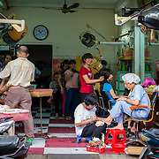 Hairdresser shop in a market in Saigon