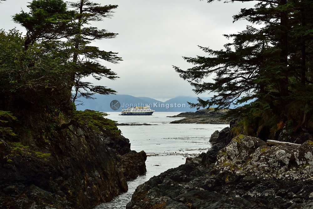 A small cruise ship at anchor off the coast of SGang Gwaay or Anthony Island, Haida Gwaii, British Columbia.