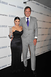 KIM KARDASHIAN and PETER JONES at the Glamour Women of The Year Awards 2011 held in Berkeley Square, London W1 on 7th June 2011.