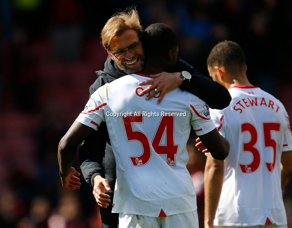 17.04.2016. Vitality Stadium, Bournemouth, England. Barclays Premier League. Bournemouth versus Liverpool. Liverpool manager Jurgen Klopp hugs Liverpool's Sheyi Ojo at the final whistle.
