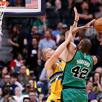 10 March 2017: Denver Nuggets center Mason Plumlee (24) defends on Boston Celtics center Al Horford (42) during the Denver Nuggets 119-99 victory over the Boston Celtics, at the Pepsi Center, Denver, Colorado, USA.