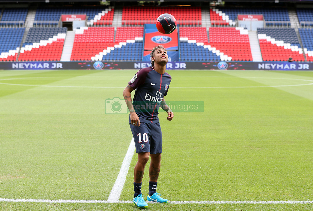 Neymar performs skills pitchside after a press conference at the Parc des Princes, following his world record breaking £200million transfer from FC Barcelona to Paris Saint Germain.