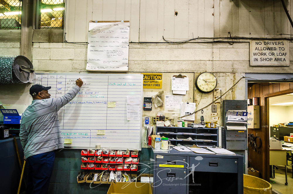 A mechanic at Highway Transport Chemical adds a repair job to the whiteboard, Dec. 17, 2014, at the company's headquarters in Knoxville, Tenn. (Photo by Carmen K. Sisson/Cloudybright)