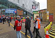Fans arrive before the NFL International Series game between the Carolina Panthers and the Tampa Bay Buccaneers at Tottenham Hotspur Stadium, Sunday, Oct. 13, 2019, in London.  The Panthers defeated the Buccaneers 37-26. (Gareth Williams/Image of Sport)