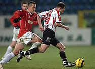 n/z.: Dariusz Dudka (nr18-Wisla), Marcin Bojarski (nr21-Cracovia) podczas meczu ligowego Wisla Krakow (czerwone) Cracovia Krakow (czerwone-biale) 3:0 , I liga polska , 4 kolejka sezon 2005/2006 , pilka nozna , Polska , Krakow , 22-11-2005 , fot.: Adam Nurkiewicz / mediasport..Dariusz Dudka (nr18-Wisla), Marcin Bojarski (nr21-Cracovia)   fight for the ball during Polish league first division soccer match in Cracow. November 22, 2005 ; Wisla Krakow (red) - Cracovia Krakow (red-white) 3:0 ; 4 round season 2005/2006 , football , Poland , Cracow ( Photo by Adam Nurkiewicz / mediasport )