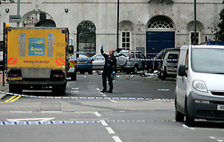 UK ENGLAND LONDON 7JUL05 - A bomb disposal expert gestures at the site of a bus explosion in central LondonAt least two people have been killed and scores have been injured after at least seven blasts on the Underground network and a double-decker bus in London...jre/Photo by Jiri Rezac ..© Jiri Rezac 2005..Contact: +44 (0) 7050 110 417.Mobile:  +44 (0) 7801 337 683.Office:  +44 (0) 20 8968 9635..Email:   jiri@jirirezac.com.Web:    www.jirirezac.com..© All images Jiri Rezac 2005 - All rights reserved.