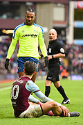 Aston Villa midfielder Jack Grealish (10) on the ground after being fouled by Derby County striker Kasey Palmer (7) during the EFL Sky Bet Championship match between Aston Villa and Derby County at Villa Park, Birmingham, England on 28 April 2018. Picture by Jon Hobley.