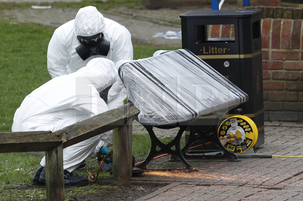 © Licensed to London News Pictures. 23/03/2018. Salisbury, UK. Police in protective suits and gas masks work to remove the bench where former Russian spy Sergei Skripal and his daughter Yulia were poisoned with nerve agent in Salisbury. The couple where found unconscious the bench in Salisbury shopping centre. Photo credit: Peter Macdiarmid/LNP