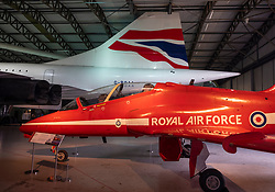 British Airways Concorde and Red Arrows Hawk on display in hanger at National Museum of Flight at East Fortune Airfield in East Lothian, Scotland, United Kingdom