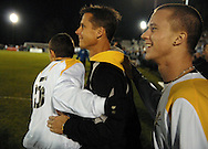 19 NOV. 2020 -- FENTON, Mo. -- St. John Vianney High School soccer .coach Dave Gauvain (center) is congratulated by Alex Tankersley (5) and Tommy Dapron (19) after the Griffins beat St. Louis University High School 2-0 during the MSHSA Class 3 state soccer semifinal at the A-B Center in Fenton, Mo. Friday, Nov. 19, 2010. Vianney advances to the Class 3 title game Saturday night. Image © copyright 2010 Sid Hastings.
