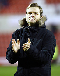 Swindon Town Manager, Mark Cooper claps the fans at full-time - Photo mandatory by-line: Joe Dent/JMP - Tel: Mobile: 07966 386802 11/01/2014 - SPORT - FOOTBALL - County Ground - Swindon - Swindon Town v Peterborough United - Sky Bet League One