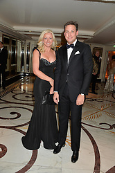 MICHELLE MONE and JEFF HOLLAND at a birthday dinner for Claire Caudwell for family & friends held at The Dorchester, Park Lane, London on 24th January 2014.