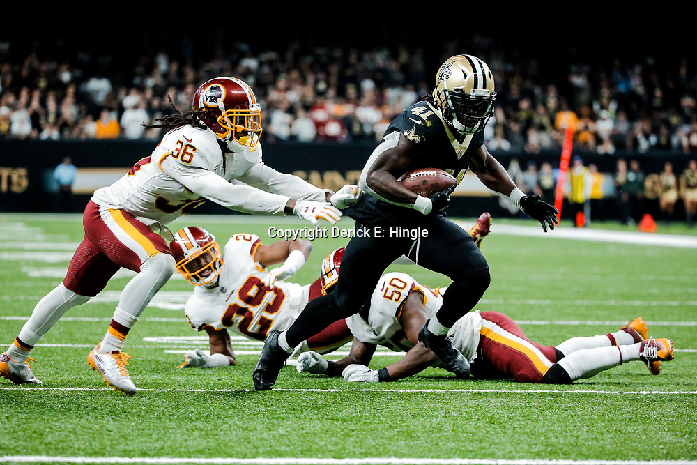 Nov 19, 2017; New Orleans, LA, USA; New Orleans Saints running back Alvin Kamara (41) breaks away from Washington Redskins safety D.J. Swearinger (36) for a touchdown during the fourth quarter of a game at the Mercedes-Benz Superdome. The Saints defeated the Redskins 34-31 in overtime. Mandatory Credit: Derick E. Hingle-USA TODAY Sports