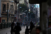 Egyptian riot police battle rock throwing protesters in the Bulaq district during continuing January 26, 2011 demonstrations in downtown Cairo, Egypt. A series of unprecedented demonstrations have broken out across Egypt for the past two days, inspired by the revolution in Tunisia, and intended to spark a similar movement in Egypt. (Photo by Scott Nelson)