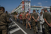 Donetsk, Ukraine - August 24, 2014: Pro-Russian rebels (at left) escort dozens of Ukrainian soldiers prisoners of war as they parade them to the public through Lenin Square in central Donetsk, the day Ukraine celebrate their 23rd Independence Day. CREDIT: Photo by Mauricio Lima for The New York Times