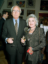 LORD & LADY YOUNG OF GRAFFHAM at an exhibition in London on 27th May 1997.LYR 28